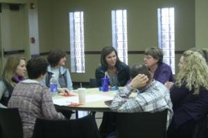 Team members from Iowa, Tama, & Poweshiek counties discuss ties to their communities.