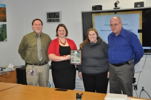 Iowa County WLL team representatives accept the 2015 Group Civil Rights award from the joint USDA Civil Rights Committee. From left to right: NRCS Assistant State Conservationist for Management and Strategy Jon Hubbert, NRCS District Conservationist Katherine Timmerman, IDALS State Secretary Leslie Maxwell and NRCS Assistant State Conservationist for Field Operations Kevin McCall.
